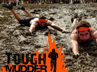 Tough Mudder contestant in mud
