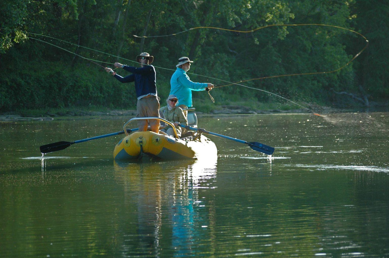Fisherman on raft flyfishing