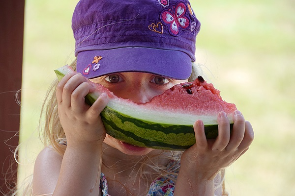 Young girl enjoying the McDade Watermelon Festival