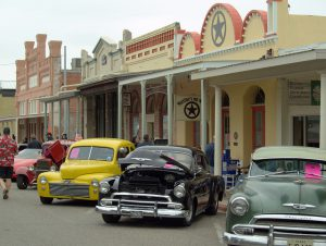 Classic cars lined up on Main Street Bastrop