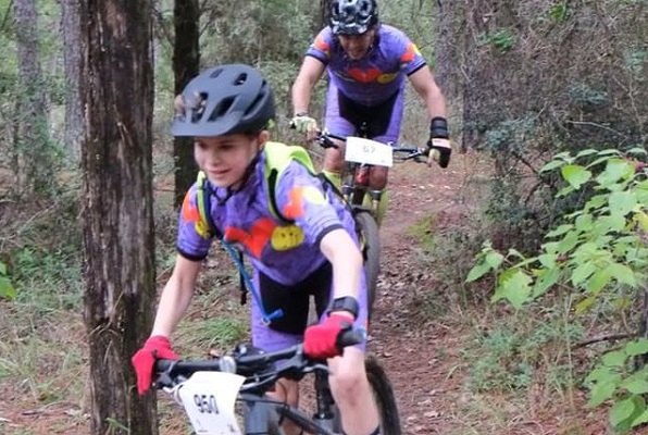 Mountain bike riders coming down a trail at Rocky Hill Ranch in Smithville Texas.