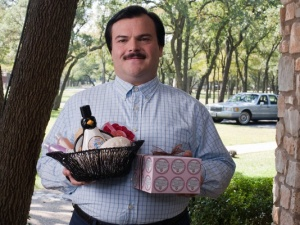 Jack Black as Bernie offering a gift basket.