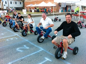 Tricycle races at the Kid's Fest at Smithville's Festival of Lights in Texas