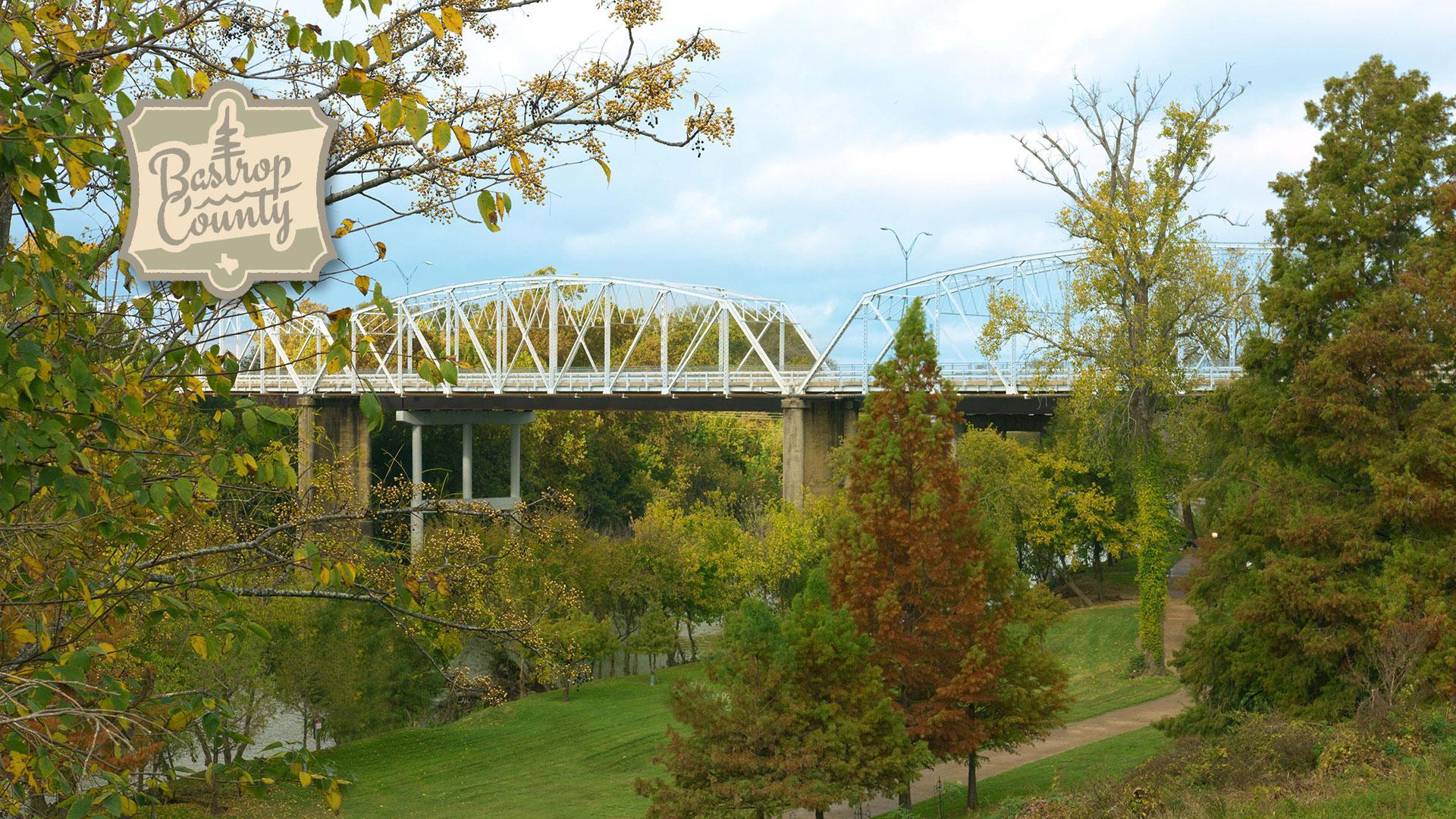 View of Bastrop Bridge from river banks