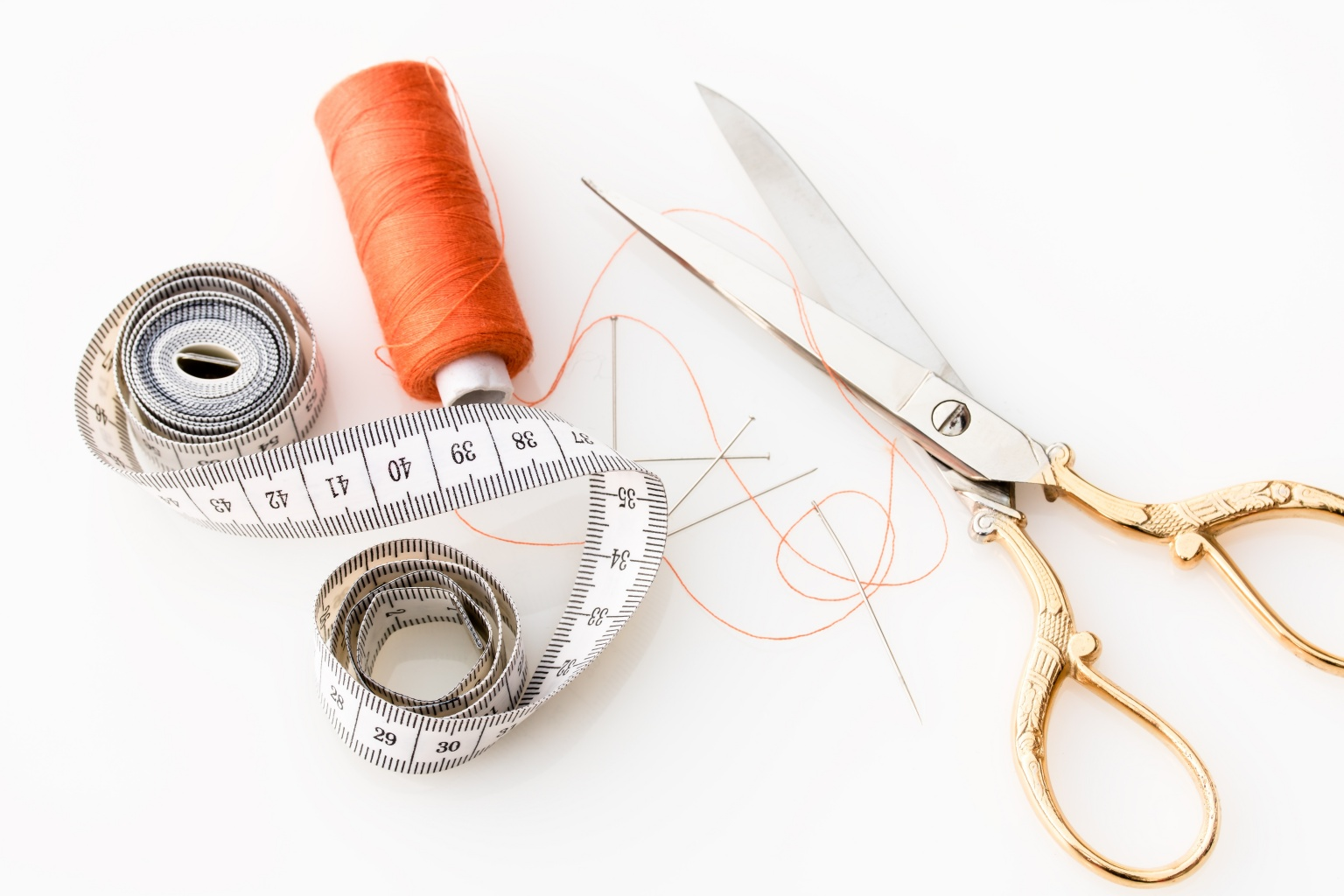 Scissor, Needle, tape measure and thread